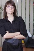 Female employee in office — Stock Photo