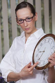 Unhappy woman with big clock — Stock Photo