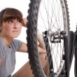 Stock Photo: Unhappy womwith defect bike