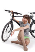 Young woman with bike — Stock Photo