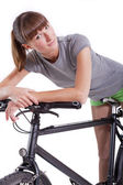 Woman resting on her bike — Stock Photo