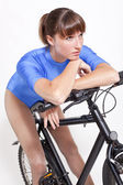 Fitness woman on bicycle — Foto de Stock