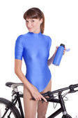 Fitness woman with bike and bottle — Stock Photo