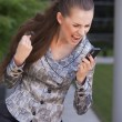 Woman screaming on cell phone — Stock Photo