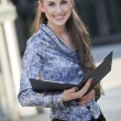 Happy businesswoman with document folder — Stock Photo #3401940