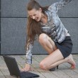 Woman beats laptop with shoe — Stock Photo #3402021