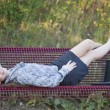 Woman relaxing on the bench — Stock Photo