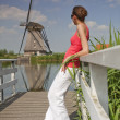 Woman and windmill — Photo