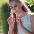 Young bride with daisy plant — Stock Photo #3478394