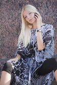 Blond woman with cell phone — Stock Photo