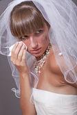 Crying bride with handkerchief — Stock Photo