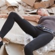 Dead woman in paper cartons — Stock Photo