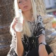 Woman drinking water from bottle — Stockfoto