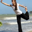 Yogexercises on beach — Stock Photo #3549868