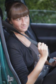 Woman with safety belt in car — Stock Photo