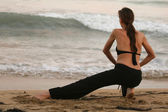 Stretching exercises on the beach — Stock Photo