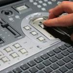 Hand on video mixer — Stock Photo