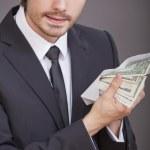 dólares de exploração do empresário em envelope — Foto Stock