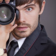 Photographer in business suit — Stock Photo