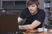 Male programmer with headset — Stock Photo