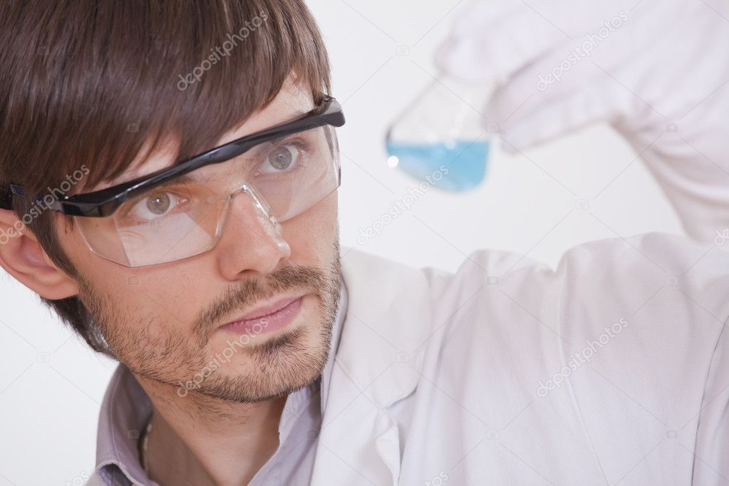 Chemical researcher with colourful flask in a lab  Stock Photo #3605412