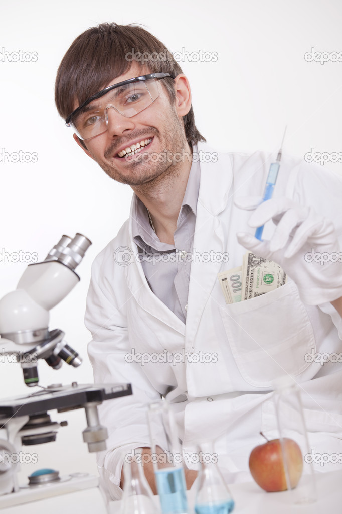 Corrupted scientist with syringe manipulating doping substances — Stock Photo #3605441
