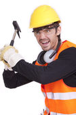 Angry worker with hammer — Stock Photo