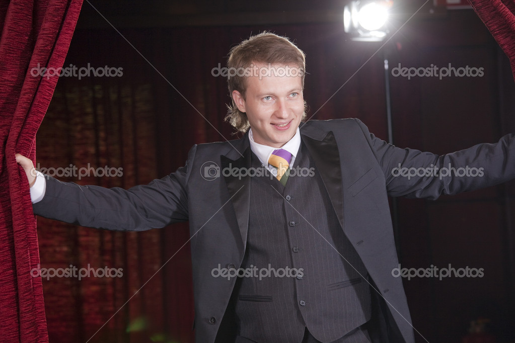 Male actor in spotlight on the stage — Stock Photo #3694411