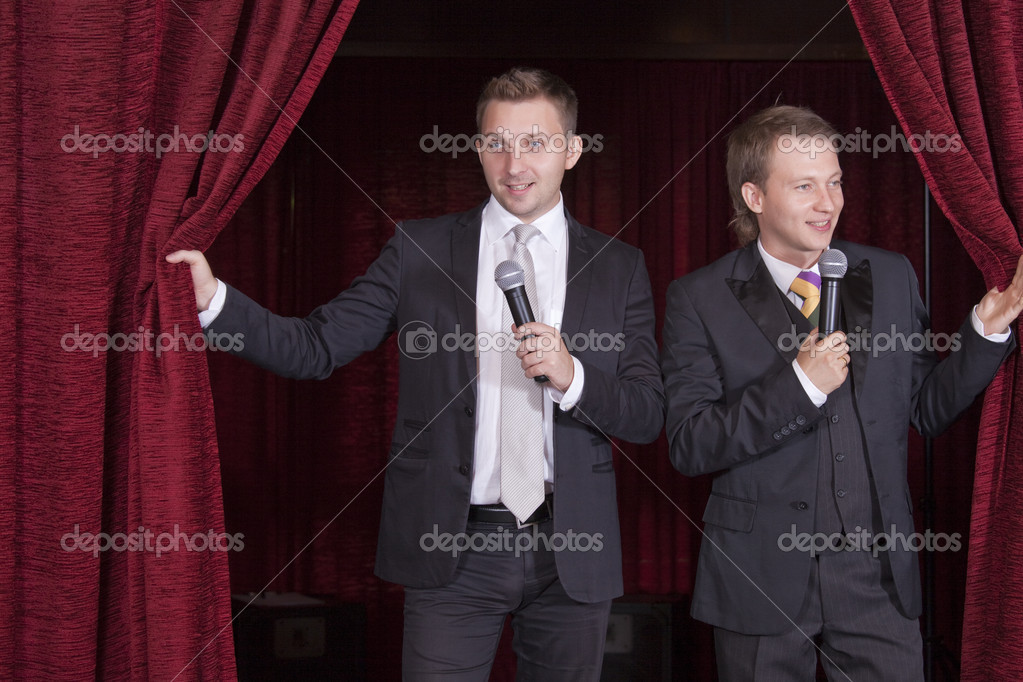 Two comedian actors with microphones on stage  Stock Photo #3694417