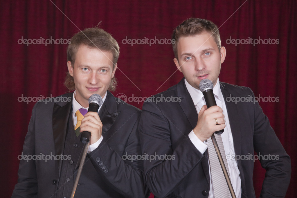 Two male entertainers with microphones on the stage  Stock Photo #3694455