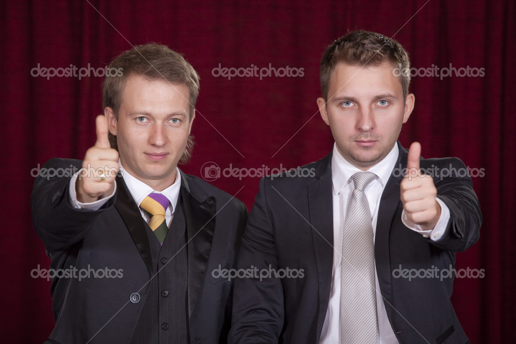 Two male actors holding thumbs up on the stage — Stock Photo #3694469