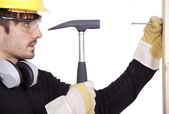 Handyman with hammer — Stock Photo