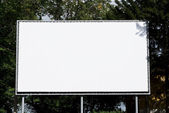 Empty billboard on background wood — Stock Photo