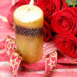 Stock Photo: Claret rose and candle