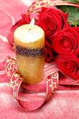 Claret rose and candle — Stock Photo