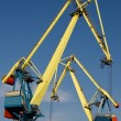 Two big port cranes working — Stock Photo #3153534