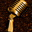 Coffee beans and microphone - Stock Photo