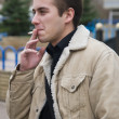 Smoking young guy — Stock Photo