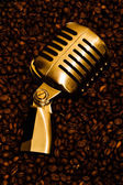 Coffee beans and microphone — Stock Photo