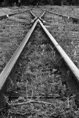 Grungy rails in monochrome — Stock Photo