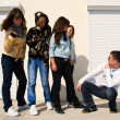 Group of 5 young near white wall — Stock Photo #3188102