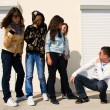 Stock Photo: Group of 5 young near white wall