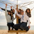 Teenage friends company at the beach — Stock Photo