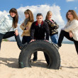 Stock Photo: Group of five teenagers at the seaside