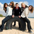 Company of teenage friends at the beach — Stock Photo