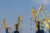 Four big industrial level luffing cranes — Stock Photo