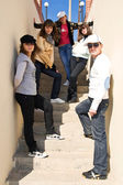 Group of young standing on stairs — Stock Photo