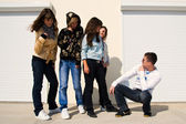 Group of 5 young near white wall — Stock Photo