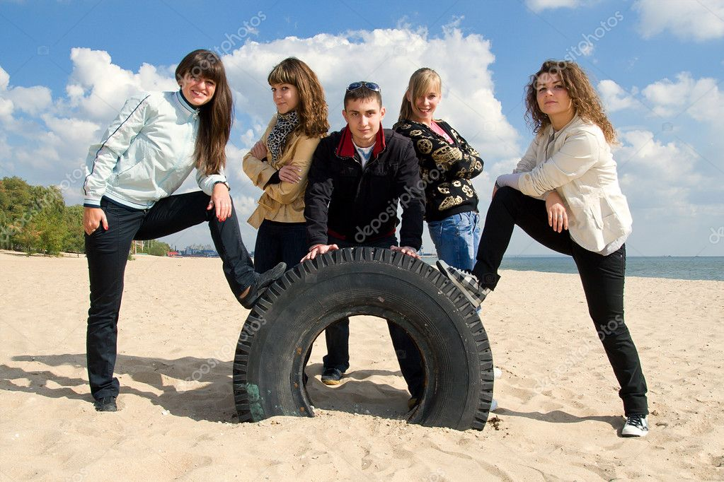 Company of five teenage friends on the beach — Stock Photo #3188175