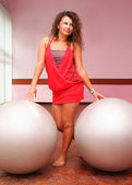 Young girl with two fitness balls — Stock Photo
